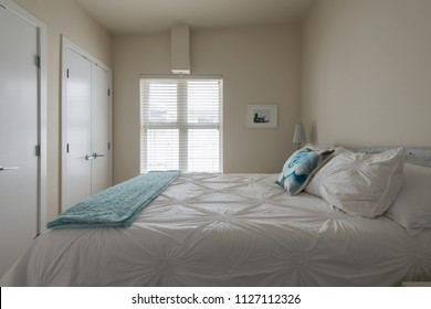 Modern bright bedroom interior design with designer pillows in a luxury house, hotel.