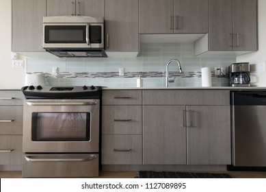 Modern, bright, clean, kitchen with stainless steel appliances. Interior design.