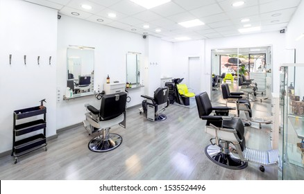 Modern bright hair and beauty salon. Barber salon interior business with black and white luxury decor. - Shutterstock ID 1535524496