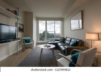 Modern bright living room in a luxury apartment. Interior design.