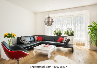 Modern bright living room with wooden floor