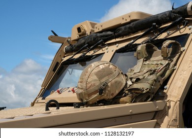 Modern British military scout vehicle with soldiers helmet.