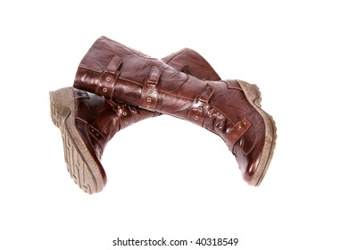 Modern brown boots isolated on a white background.