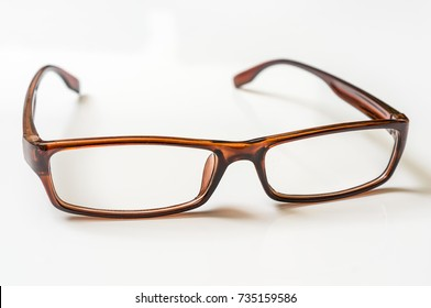 Modern brown eyeglasses isolated on white background