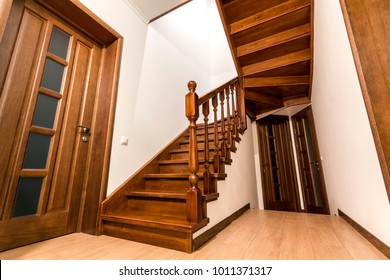 Great Modern Brown Oak Wooden Stairs And Doors In New Renovated House Interior
