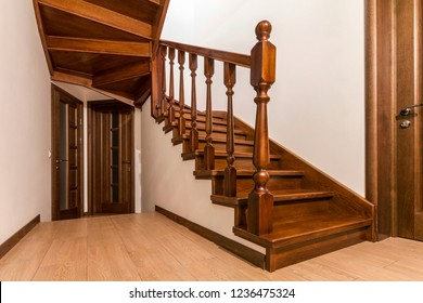 Modern brown oak wooden stairs  and doors in new renovated house interior