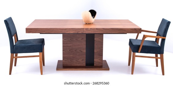 modern brown wooden dining table and chairs isolated on a white background