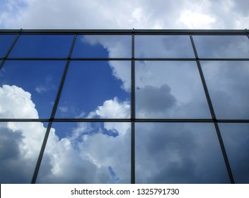 modern building, blue sky mirrored in the windows