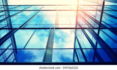 Modern building in the city with sunlight. Abstract texture and blue glass facade in modern office building., Retro stylized colorful tonal filter effect.