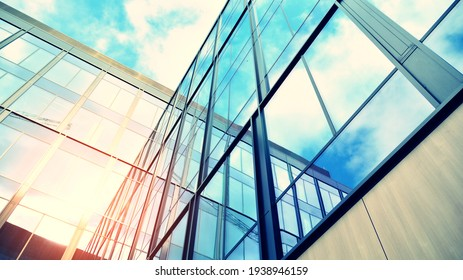 Modern building in the city with sunlight. Abstract texture and blue glass facade in modern office building., Retro stylized colorful tonal filter effect. Sunlight.