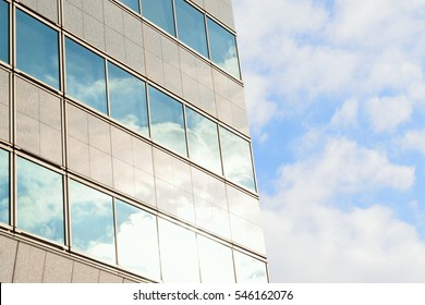 Modern building with clouds & sunshine in horizontal frame