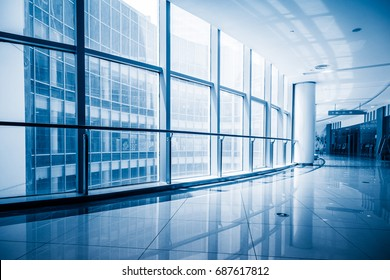 modern building corridor with glass windows,blue toned,china.