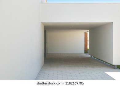 Modern building entrance and white facade. Minimalism architecture. Horizontal