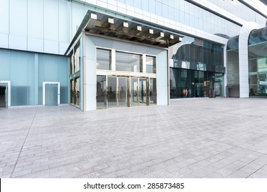 Modern building facade with empty cement road for copy space.