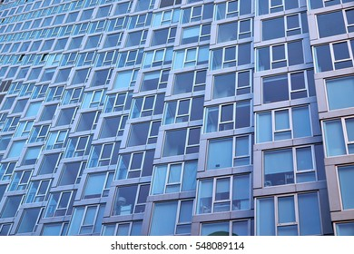 Modern building facade with window sections of aluminum, being tilted, in an apartment building in New York City