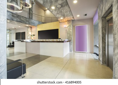 Modern building lobby with reception desk