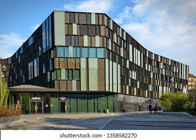 Modern building made of dark steel and glass, headquarters of the Lavazza company, leader in coffee production, Turin, Italy - march, 2019