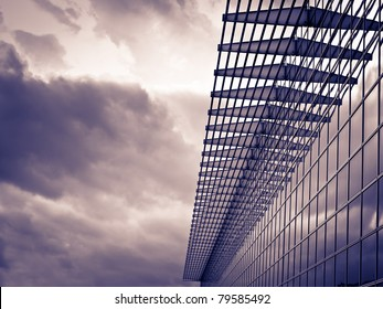 Modern  building on the cloudy weather, toned image, for architecture,business,construction,real estate themes