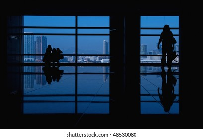 modern building and people silhouettes