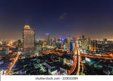 Modern building at riverside in twilight scene at Bangkok, Thailand