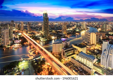 Modern building at riverside in twilight scene[Bangkok, Thailand]