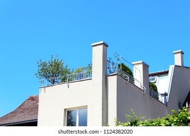 Modern building with roof terrace, blue sky above