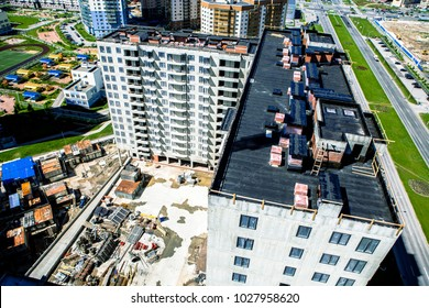 Modern building site. Construction of high rise building top view. Flat roof, waterproofing roof thermal insulation construction site