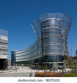 Modern building with Skeletal stainless steel façade set against vivid blue sky