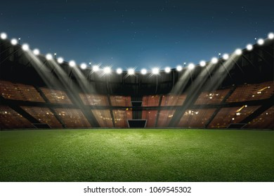 Modern building of soccer stadium with illumination on the night
