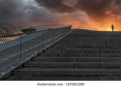 Modern building stairs on the downtown of Lisbon. With flashy sunset and silhouette of woman on top. Portugal. Lisbon.