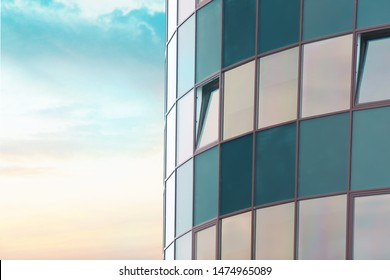 Modern building with tinted windows against sky. Urban architecture