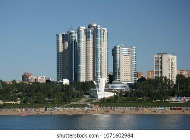 Modern buildings and beach on Volga River Embankment in Samara, Russia
