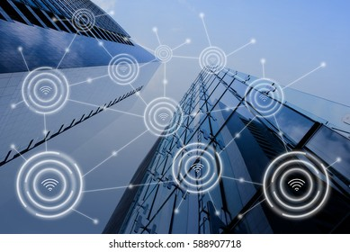 Modern buildings in blue tone with wifi icons connection, network communication in smart city, internet of things IoT concept