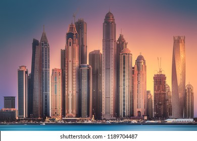 Modern buildings of Dubai Marina bay view from Palm Jumeirah during sunset, UAE. Clipping path of sky