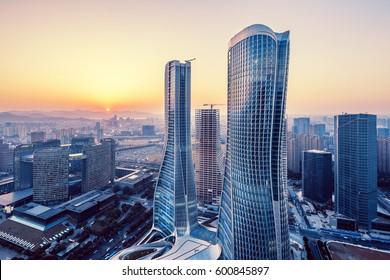 modern buildings in midtown of hangzhou new city at sunrise