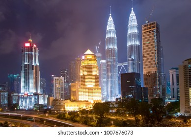 modern buildings in midtown of kuala lumpur in cloud sky at night