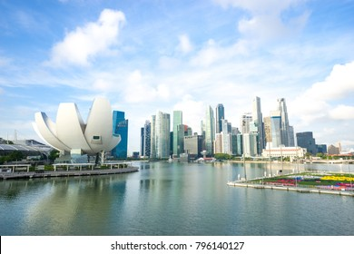 modern buildings near marina bay in singapore in cloud sky