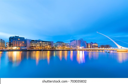Modern buildings and offices on Liffey river in Dublin, Bridge on the right is a famous Harp bridge,  Samuel Beckett Bridge
