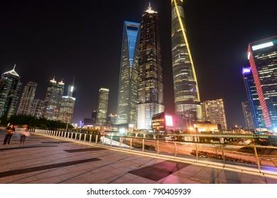 modern buildings in shanghai lvjiazui CBD from elevated walkway at night