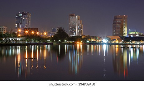 Modern buildings with skyline reflection at twilight in Bangkok,Thailand