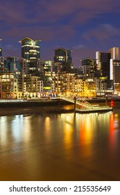 Modern buildings in the St George Wharf quarter in Vauxhall, London at night