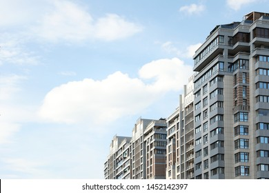 Modern buildings with tinted windows against sky. Urban architecture