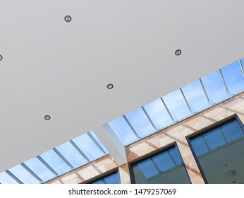 Modern business building interior with ceiling and lamps, architectural background