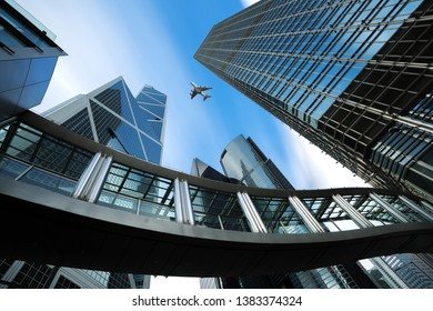 Modern business center in Hongkong. Skyscrapers in commercial area with airplane flying above at Hongkong. Asia