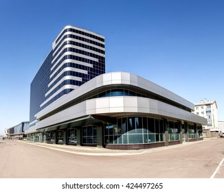 Modern business center office building with glass facade entrance