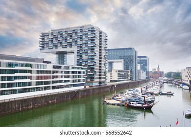 Modern business center on blue sky background in Cologne, Germany. Cologne Kranhaus - modern complex of buildings on the bank of Rhine with beautiful panoramic views in blue tones.