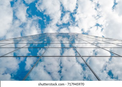 modern business high rise glass building and blue sky with clouds