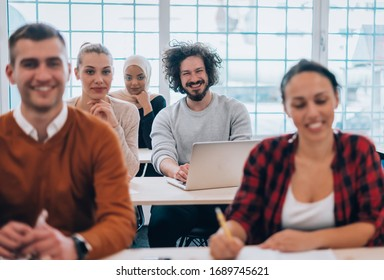 Modern business people during a discussion in a meeting room at the office
