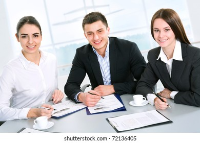 Modern business people work at a seminar