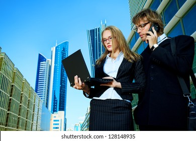 Modern business people are working together in the big city.